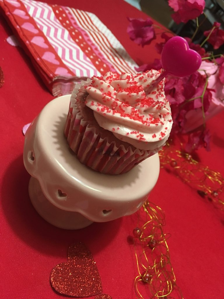 pink cupcake with raspberry frosting