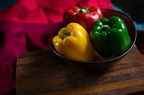 Fresh red green and yellow pepper