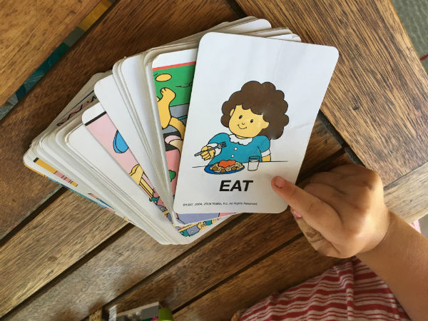 child's finger pointing to alphabet cards