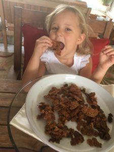 Little girl eating Granola Bark
