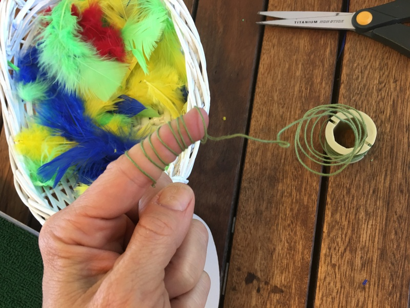 craft feathers and cloth covered wire